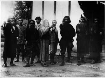 Ainu men with sword in their hands_Japan_1914